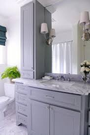 bathroom features gray shaker vanity: lovely bathroom features a gray vanity paired with a grey marble countertop and backsplash fitted with
