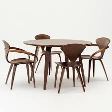 classic walnut with cherner side chairs and round table cherner furniture