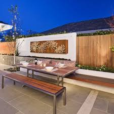 designs outdoor wall art: natural touch of outdoor wall art for cozy outdoor dining space among wooden table also bench