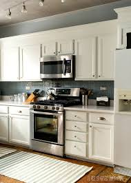 Paint Grade Cabinets Builder Grade Kitchen Makeover With White Paint