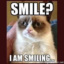 SMILE? I AM SMILING... - Tard the Grumpy Cat | Meme Generator via Relatably.com