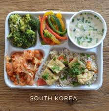 photos of school lunches served around the world reveal how meager south korean children tuck into broccoli and peppers fried rice tofu fermented cabbage