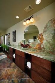 the lighting in this award winning bathroom and the focal point is the maxim lighting asian bathroom lighting