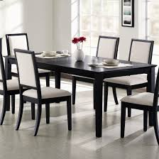 size dining room contemporary counter: dining  modern black dining room table centerpieces  chairs white leather cushions have small flower vase and some plates on top above ceramic floor around white painted wall decor