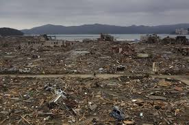 life is more than what it always seems      of  link to this photo   comments about this photo essay    a japanese survivor of the earthquake and tsunami rides his bicycle through the leveled city