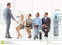 businessman shaking hands w besides people waiting for businessman shaking hands w besides people waiting for interview