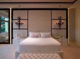 splashy quilted headboard in bedroom contemporary with hanging lamp next to headboard with light alongside lighting above bed and floating bedside table bedroom headboard lighting