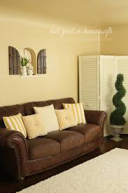 Living Room Brown Sofa Simple Small Living Room Design With Yellow Wall Painting Vintage