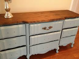 the woman we bought it from was in the process of redoing it and even though i absolutely loved the stained top with the blue however the color was almost chalk painted furniture