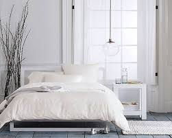 fabulous scandinavian bedroom design in minimalist color with black fur rug and white bed also warm lighting bed lighting fabulous
