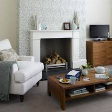 room decorate small fireplace habitat maggie mustard yellow mohair fireplaces the fireplace and room