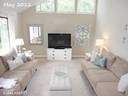 cream couch living room ideas: minimalist small living room white entertainment centre light cream sofas framed glass windows light flooring
