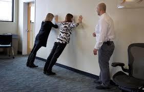 discipio watches as wbur staff do wall push ups robin lubbockwbur band office cubicle