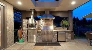 gallery outdoor kitchen lighting:  awesome outdoor kitchen design in terrace with stone backsplash along with amazing lighting in ceiling and