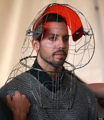 David Blaine prepares for another day at the office. Clad in a custom-made metal suit and helmet capable of conducting millions of volts of electricity, ... - o-DAVID-BLAINE-570