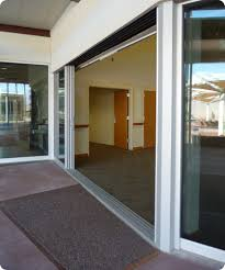 large sliding patio doors: masterful valley visitor center sliding glass doors design with brown carpet