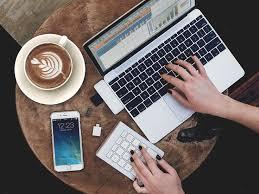 Coffee shop desk set-up featuring <b>Satechi Aluminum</b> Wireless ...