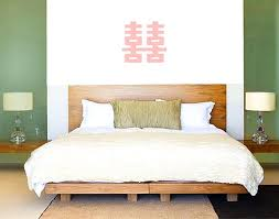 double happiness symbol above bed bedroom feng shui design