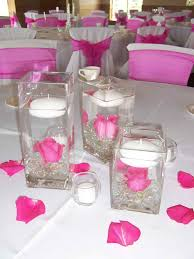 gorgeous dining table decoration with beautiful pink and white flowers combine with long vase plus uplighting cryztal combine with nice table sheet and beautiful color table uplighting