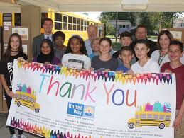 stuff a bus stops at stimson middle school in south huntington volunteers from huntington coach and united way pitched in our stimson middle school student leaders to unload a bus full of needed supplies