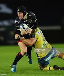 clermont s english winger david strettle rides the ball during the ospreys player sam davies in action during the european rugby champions cup pool 2 match between