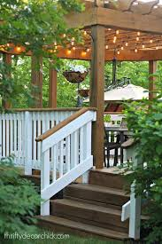 gorgeous deck with pergola lights and white railingslove thrifty decor blog 3 deck accent lighting
