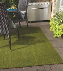 fake grass patio tundra synthetic grass tundra patio rug corner closeup