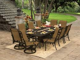patio table and 6 chairs: rectangle fire pit table witht  swivel patio chairs and  black iron patio chairs