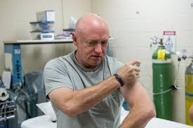 work area twin prime: former astronaut mark kelly during his lab testing and flu shot in support of the twin