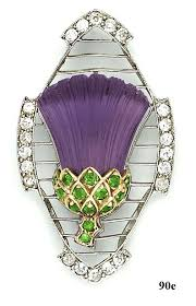 Edwardian thistle brooch, of a single <b>carved amethyst</b>, accented by ...