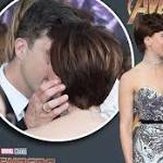 It's official! Scarlett Johansson and Colin Jost share a kiss during their red carpet debut as a couple