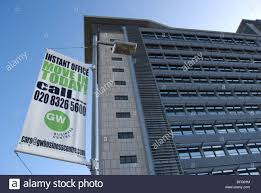 stock photo move in today on a sign advertising office space for rent with high rise building in background in brentford london england advertising office space