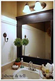 update bathroom mirror: upgrade your standard builders mirror with this diy framing project via wwwsweetpickinsfurniture