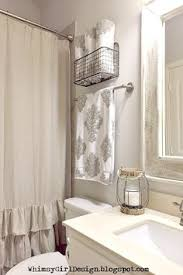 guest bathroom towels: i added a touch of farmhouse flair to our guest bathroom using this metal hanging basket