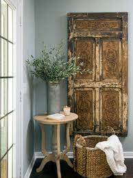chic large wall decorations living room: decorating modern blue interior design with stucco wall chic rustic wooden door art idea cool woven ropes storage basket amazing green and white living room cream painting moss red tableware for