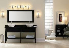 bathroom lighting fixtures over mirror and black cabinets bathroom sink lighting