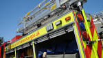 Fire crews called to split containers washed up on Norfolk beach
