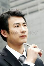 Man in <b>business suit</b> holding a <b>pen</b> stock photo , #AFF, #<b>suit</b> ...