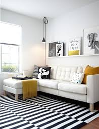 view in gallery black and white living room with elegant pops of yellow design studio revolution chic yellow living room