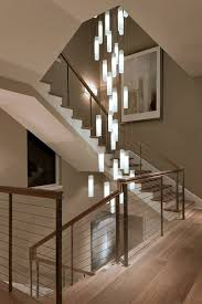 elegance in lighting galilee white candles pendant lighting suspended into a beautiful spiral stairwell candle pendant lighting