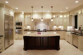 small u shaped kitchen design: this u shaped kitchen centers around a large dark wood island with classic marble countertop