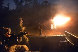 u s department of defense photo essay army green berets fire their machine guns while participating in a night assault during the southern