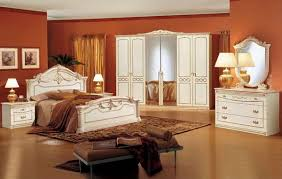 master bedroom with white furniture sets and orange wall paint colors bedroom furniture colors