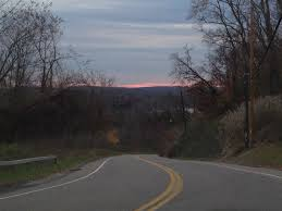 return to new york walk down memory lane little fat notebook sunset and lake in distance viewed from brewster hill steep road going down