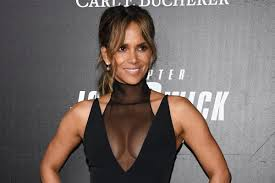 Halle Berry 'breaks from the grind' in <b>sexy</b> sheer <b>swimsuit</b>