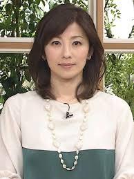 白と緑のトップスの中田有紀