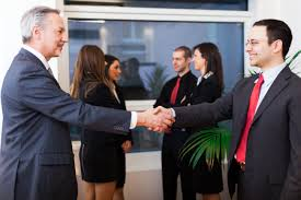 networking tips for recent college grads college recruiter businesspeople shaking hands at networking event