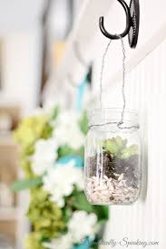 mason jar succulents with mini shells at the base for drainage adore diy hanging mason jar