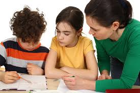 Tips for Parents   Visiting the Classroom The Learning Community Mother visiting the classroom and helping her child with schoolwork