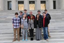 a sit down to remember arkansas teens interview gov mike beebe searcy high school students pose on the steps of the capitol building in little rock ark